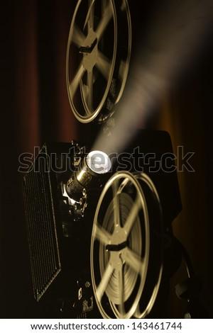 Film projector in smokey room.