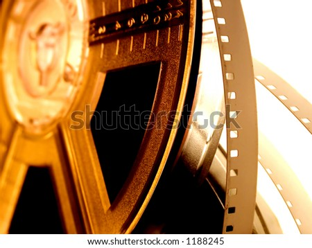 film reel isolated. Old movie reel on golden light