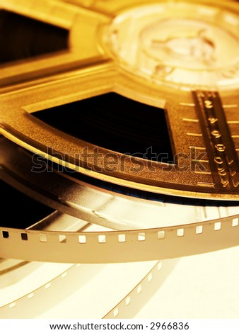 Film reel on yellow light. Movie entertainment concept