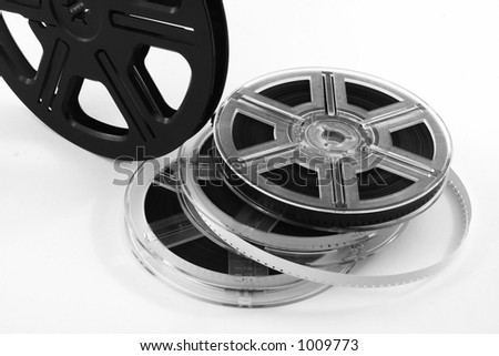 Film reels with film. Useful for movie backdrop or background. #1009773