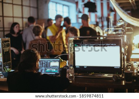 Film set, monitors and modern shooting equipment. Film crew, lighting devices, monitors, playbacks - filming equipment and a team of specialists in filming movies, advertising and TV series