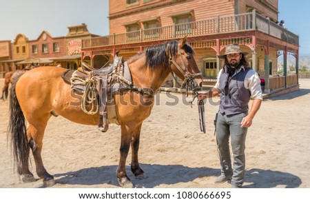 film specialist doing western movie scene