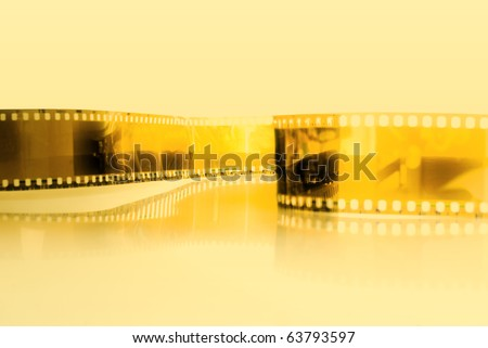 Film strip background with yellow photo filter .