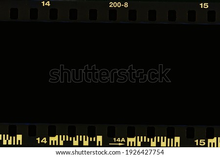 Film strip, blank photo frames, free space for your photo, real high-res 35mm film strip scan with signs of usage on bezel. blank old grunge film strip frame background. retro film border with number.