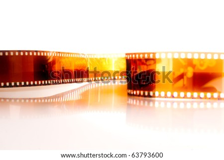 Film strip in front of a white background .
