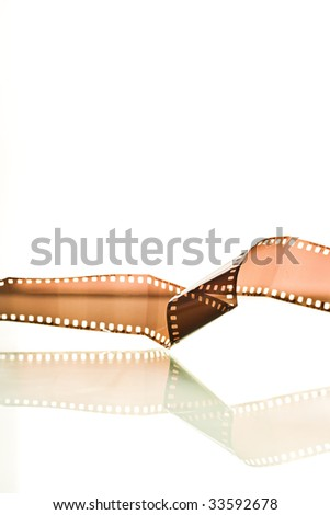 Film strip twisted reflection on white background