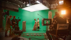Film Studio Set: Shooting Green Screen Scene with Two Talented Actors Wearing Renaissance Clothes Talking, Embraces. Period Drama Movie Backstage