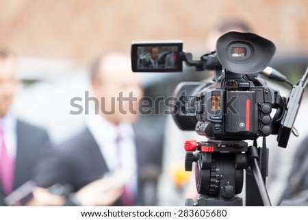 Filming an media event with a video camera