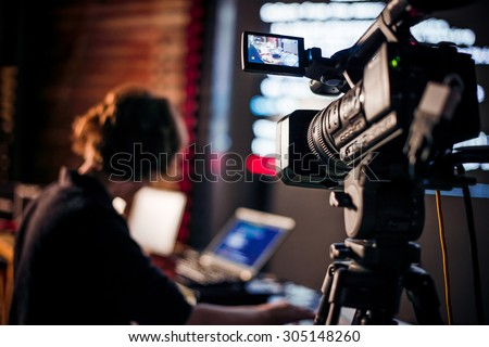 Filming creative video footage with professional video camera during the night Сток-фото ©