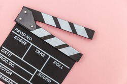 Filmmaker profession. Classic director empty film making clapperboard or movie slate isolated on pink background. Video production film cinema industry concept. Flat lay top view copy space mock up