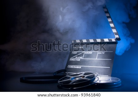 filmmaking concept scene with clapper and dramatic lighting - stock photo