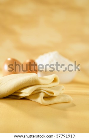 Filo pastry dough, eggs and flour on a table