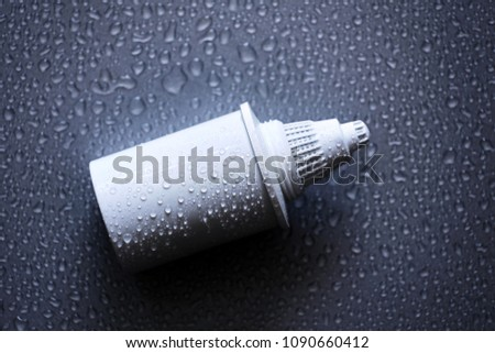 Filter cartridge on a black background #1090660412