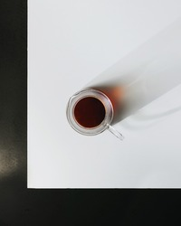 Filter coffee in a glass jug on a white table top