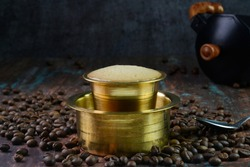 Filter coffee served in a brass cup