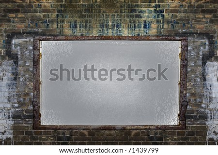Filthy brick wall with empty framed board