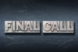 final call phrase made from metallic letterpress on dark jeans background