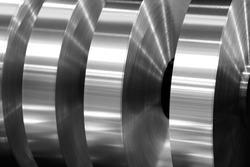 final coils of aluminum foil after sliting on the axis machine, black and white photo