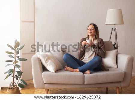 Finally coffee. Young coffee lover sniffing hot drink at cozy home interior, empty space Foto stock ©