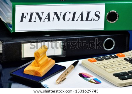 Finance accounting business organization.Finance is a category of resource allocation.On the office Desk calculator for calculations, pen for writing, chart work, folders files with important plans.