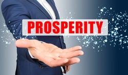 Finance and business concept. A businessman holds his hand, palm up, above the palm the inscription - PROSPERITY