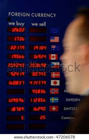 Finance and business image of a man rushing past a currency board