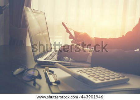 Finance & Business.man's hands using smart phone in interior,business man use cell phone,technology,internet,student working with laptop and mobile phone,vintage color,selective focus  - Shutterstock ID 443901946