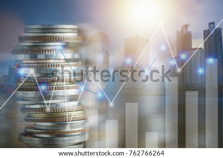 Finance, capital banking and investment concept, Double exporsure stacked of coins and night city with graph