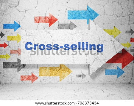 Finance concept:  arrow with Cross-Selling on grunge textured concrete wall background, 3D rendering