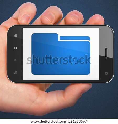 Finance concept: hand holding smartphone with Folder on display. Generic mobile smart phone in hand on Dark Blue background.