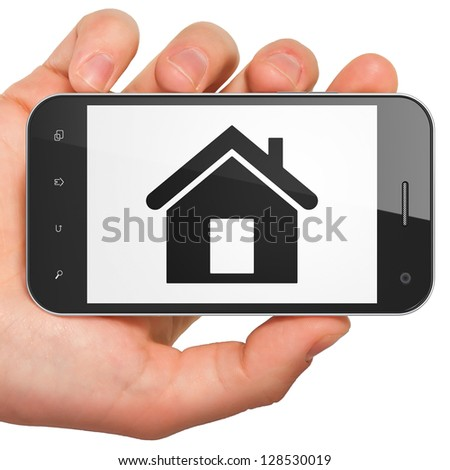 Finance concept: hand holding smartphone with Home on display. Generic mobile smart phone in hand on White background.