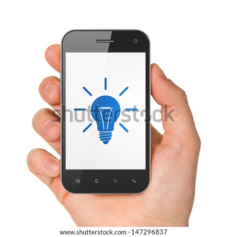 Finance concept: hand holding smartphone with Light Bulb on display. Generic mobile smart phone in hand on White background.