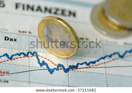 Finance, Euro coins on a chart
