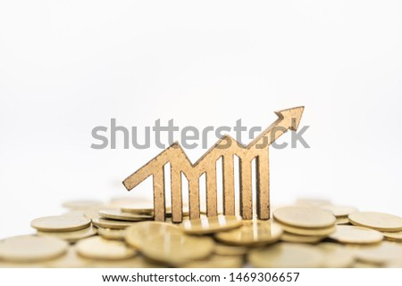 Finance Money and Business Concept. Close up of wooden chart growth with arrow icon on pile of gold coins on white background. #1469306657