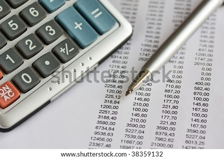 Finance report with a pen and calculator