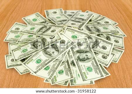 Finances big pile of money over table stock photo