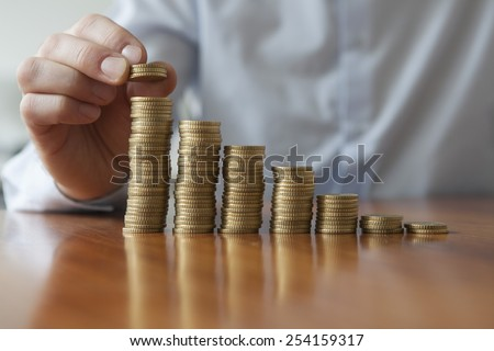 Finances, Person stacking Euro coins, close-up