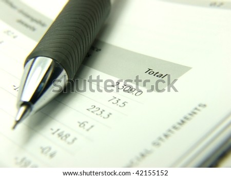 Finances statement with pencil