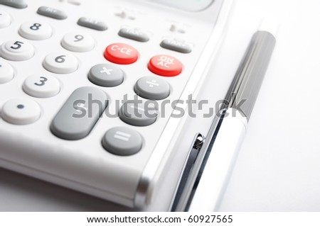 financial accounting concept with white calculator in office
