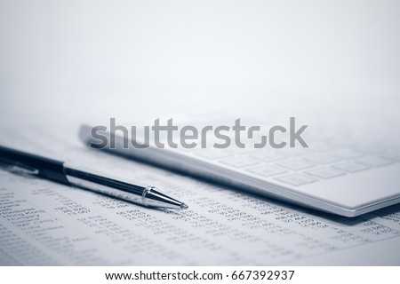 Financial accounting. Pen and calculator on business report #667392937