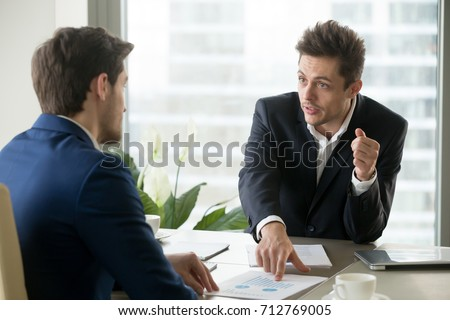 Financial analyst explaining reasons of company growth deceleration and giving advices how to reach success in next quarter. Businessman drawing attention of partner on value indicators during meeting