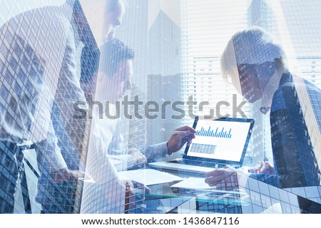 financial analytics, business team working on charts and big data on screen of computer, double exposure