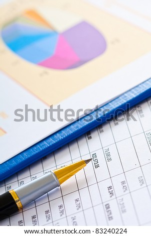 Financial and business documents on a table
