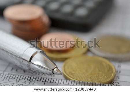 Financial background with money, ruler, calculator and pen. - stock photo