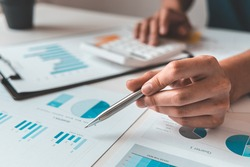 Financial businessman calculating corporate income tax data And analyzing charts of financial stocks that are in good condition with growth and progress, Investment in finance and accounting.