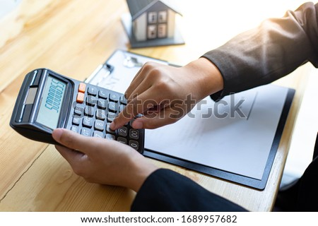Financial businessmen are calculating and analyzing property investment costs, Business Financing Accounting Concept.