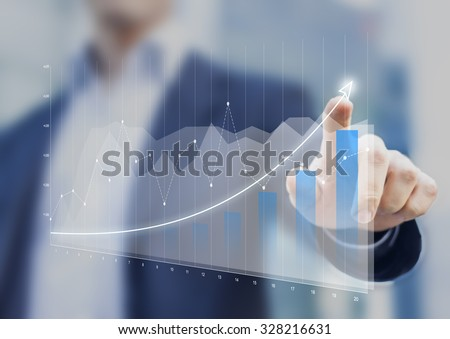 Photo of  Financial charts showing growing revenue on touch screen