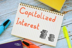 Financial concept about Capitalized Interest with sign on the piece of paper.