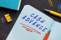 Financial concept about CASH ADVANCE with phrase on the page. Acash advanceis a short-term loan from a bank or an alternative lender.