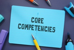 Financial concept about Core Competencies with inscription on the piece of paper.